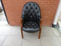 A Black Leather Chesterfield Directors Chairs