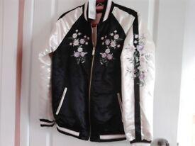 Ladies bomber jacket.