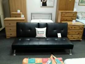 Futon with arm rest/cup holders upholstered in black leather - British Heart Foundation