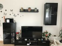 Black LED TV stand with 3 piece matching living room set