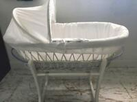 White Moses basket and White rocking stand.