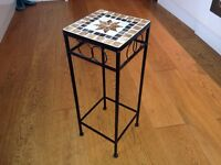 Wrought iron table / plant stand with ceramic tile mosaic top.