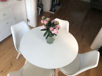 Round bistro table with four chairs