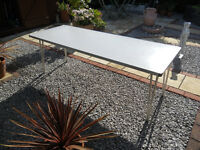 LARGE METAL FRAME TABLE WITH FOLDAWAY LEGS AND EASY CLEAN TOP
