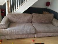Beige fabric 4 seater sofa.