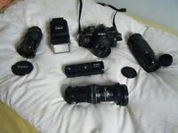 Minolta 35mm SLR camera & zoom lenses .