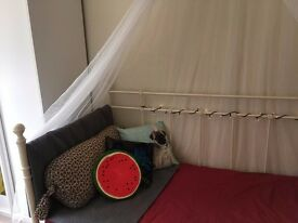 Beautiful white metal day bed with mattress