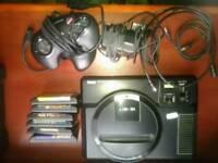 Sega Mega Drive games console / 2 controllers / 6 games