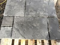 Dark gray flagstone paving slabs