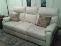 LEATHER SUITE & FOOTSTOOL UNDER 2 YEARS OLD WITH ELECTRIC RECLINERS ON SOFA