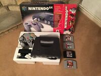 N64 complete boxed plus 4 games