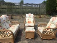 A beautiful set of Conservatory furniture. Cane bases with deep floral cushions