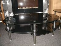 Grey smoke glass and chrome tiered coffee table and two matching occasional tables