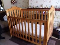 dropside cot plain wood finish good condition,some bedding included