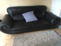 Two black sofas, excellent condition. One three seater one two seater. Collection only. £50