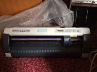 Mimaki CG-60SR cutting plotter assorted vinyl and accessories.
