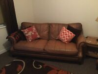 Distressed tan leather sofa + armchair
