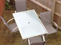 Heavy glass garden table 4 chairs