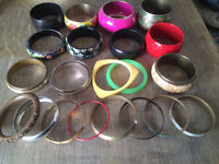 7 bunches of different size and coloured bracelets