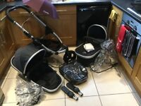 Icandy peach jogger pram with carrycot, rain covers, car seat adaptors, parasol, cosytoes in black