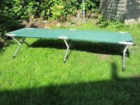 Two Foldable Camp Beds - Green with Storage Bags in Very Good Condition