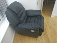 Black fully reclinable arm chair