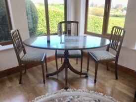 Oval Mahogany dining table with three chairs