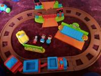 Toy bundle including HappyLand train set with extra track pieces
