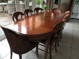 Grange dining table and 8 chairs in cherrywood.