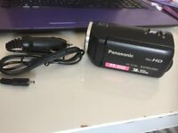Panasonic compact camcorder, comes with case and charger.