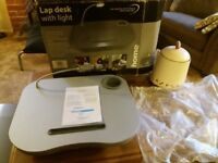 Lap desk with LED Light on top of never been used. Still in box, box little tatty.