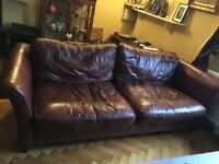 Large comfy 4 seater leather sofa, some cat damage