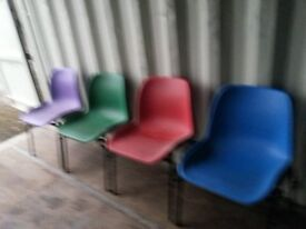 stackable coloured chairs.