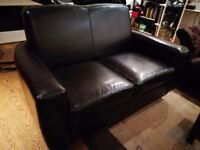 2 seater black leather sofa, great condition £130