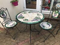 Two Bistro table and pair of chairs sets