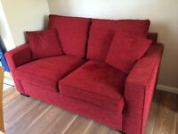 Metal sprung red sofa bed with mattress