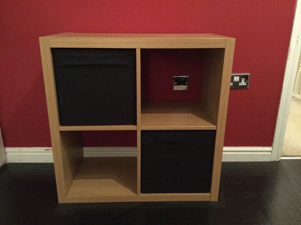 ikea kallax storage unit in oak veneer with two black boxes | in