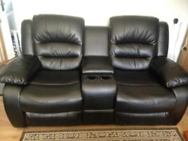 Black 2 seater recliner settee with cup holders and under arm remote storage