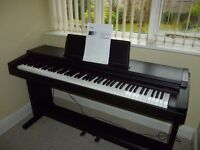 Roland keyboard on piano stand. Virtually unused, and ready to be an ideal xmas gift