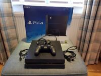 PS4 500GB IN BLACK PLUS ONE CONTROLLER AND ONE GAME
