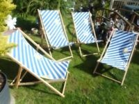 four folding deck chairs