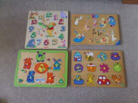 4 wooden puzzles including a Winnie the Pooh puzzle clock