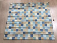 Two blue and tan chequered pattern Roman blinds with track and fittings.