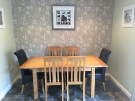 Extendable oak dining table -