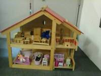 Beautiful wooden dolls house with furniture, ideal Christmas present