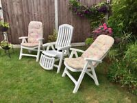 3 white reclining garden chairs with cushions