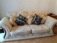 Large cream pattern sofa and matching chair