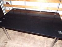 Black glass dining table - can deliver