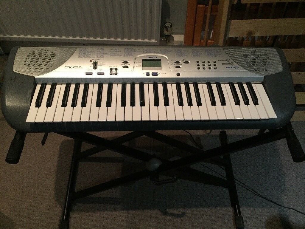 Fantastic CASIO Electric Keyboard with Stand