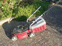 Small lawn mower with grass box. Good working order.